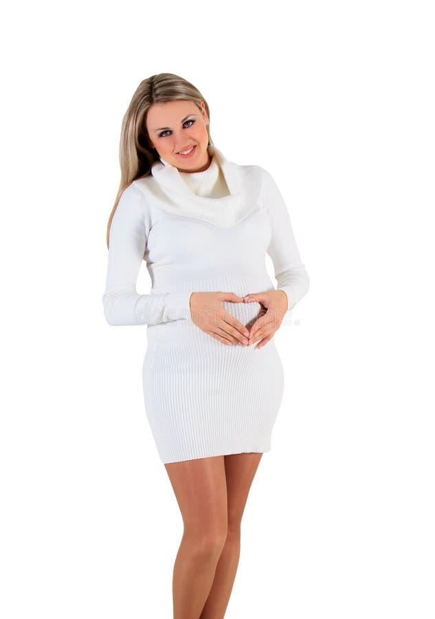 Беременная женщина - изолированная над белой предпосылкой стоковые фотографии rf