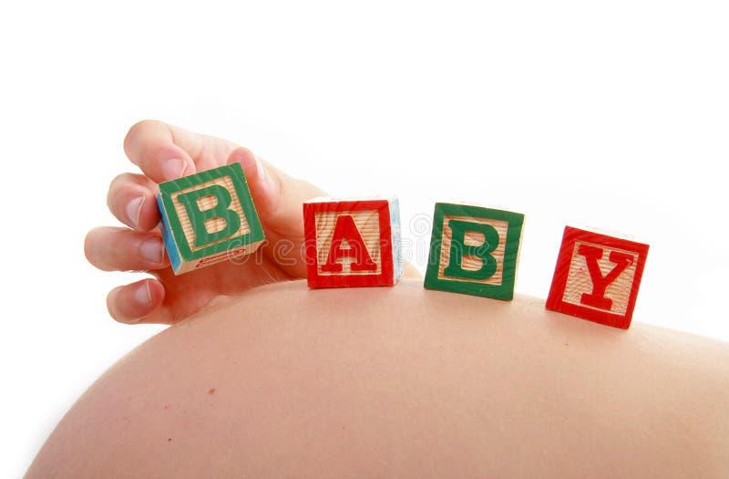 беременная женщина кубика младенца стоковые изображения rf