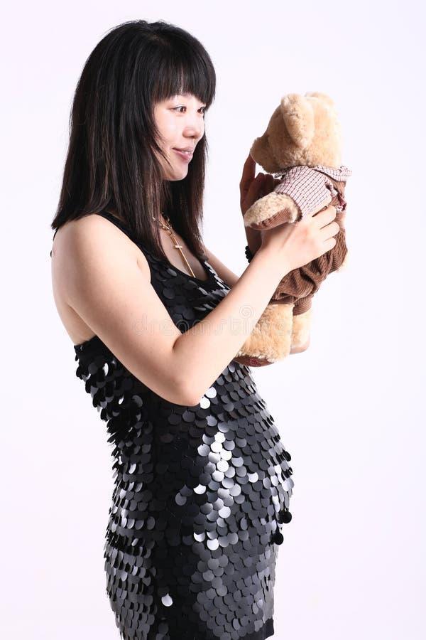беременная женщина способа Азии стоковые фото