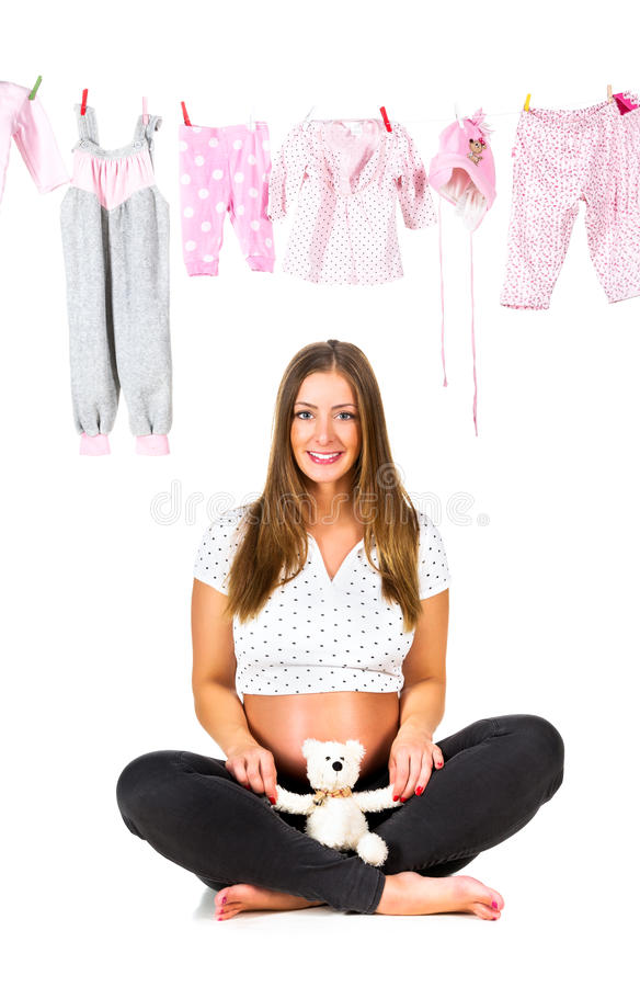 Беременная молодая женщина, изолированная на белизне стоковые фото