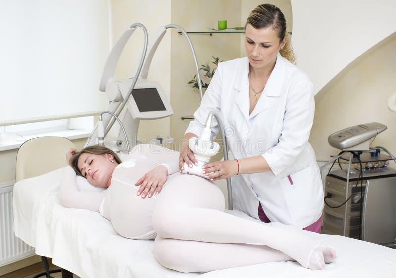 Беременные женщины Lipomassage стоковое фото rf