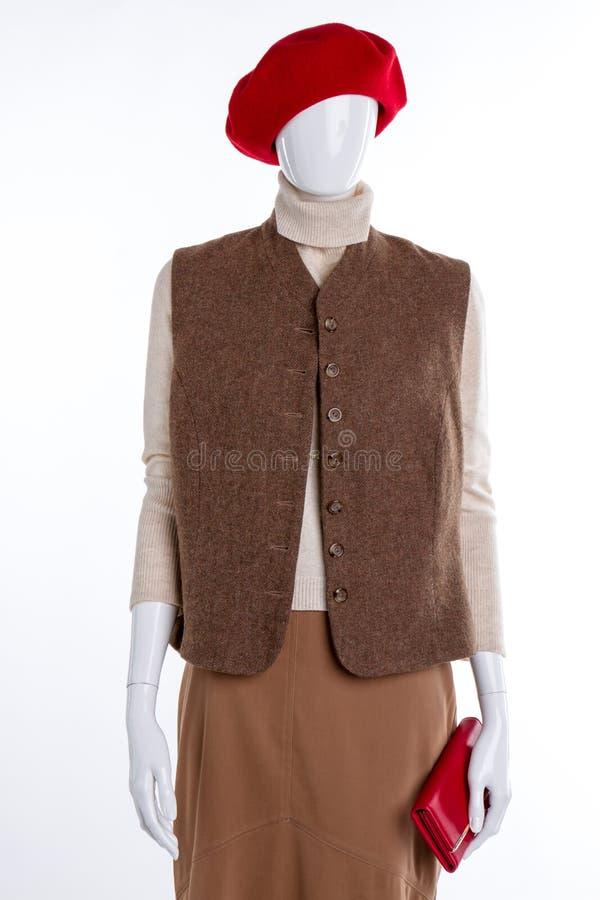 Берет, свитер, жилет и юбка стоковое изображение