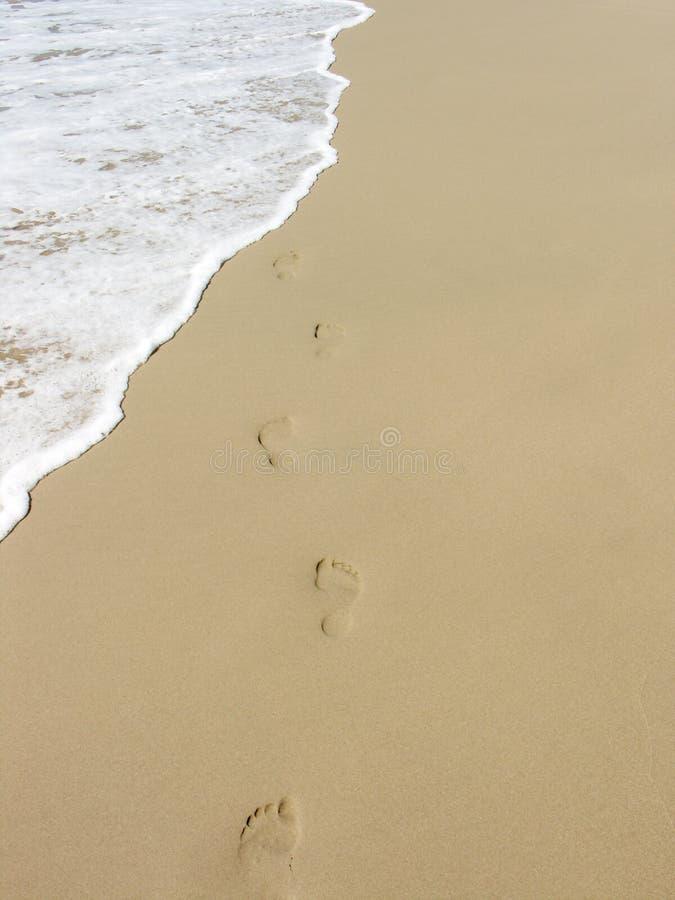 беспечальные следы ноги стоковое изображение
