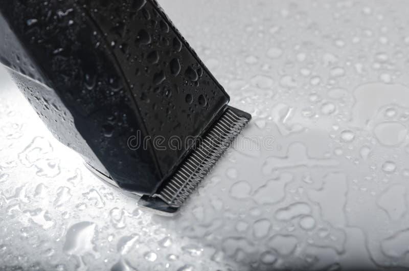 Бесшнуровой черный конец электробритвы вверх стоковая фотография rf