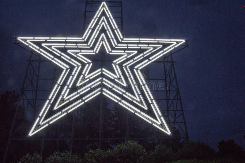 Белая неоновая звезда стоковые фотографии rf