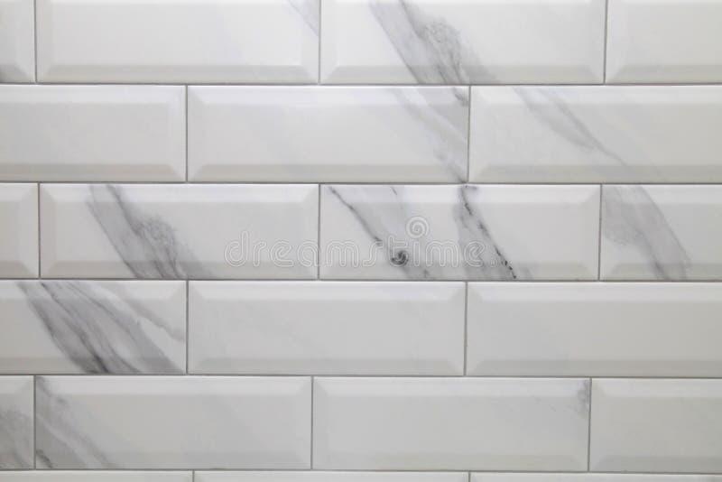 Белая предпосылка керамической плитки метро стоковые фото