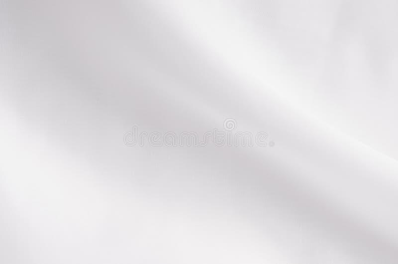 Белая ровная элегантная текстура ткани шелка или сатинировки с жидкостной волной стоковое фото rf