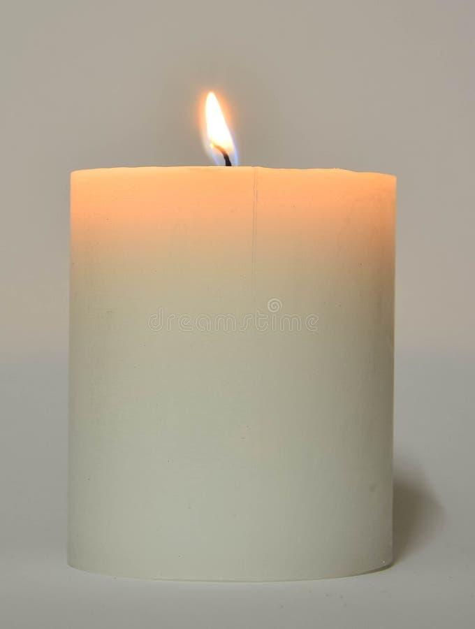 Белая свеча с пламенем стоковые изображения rf