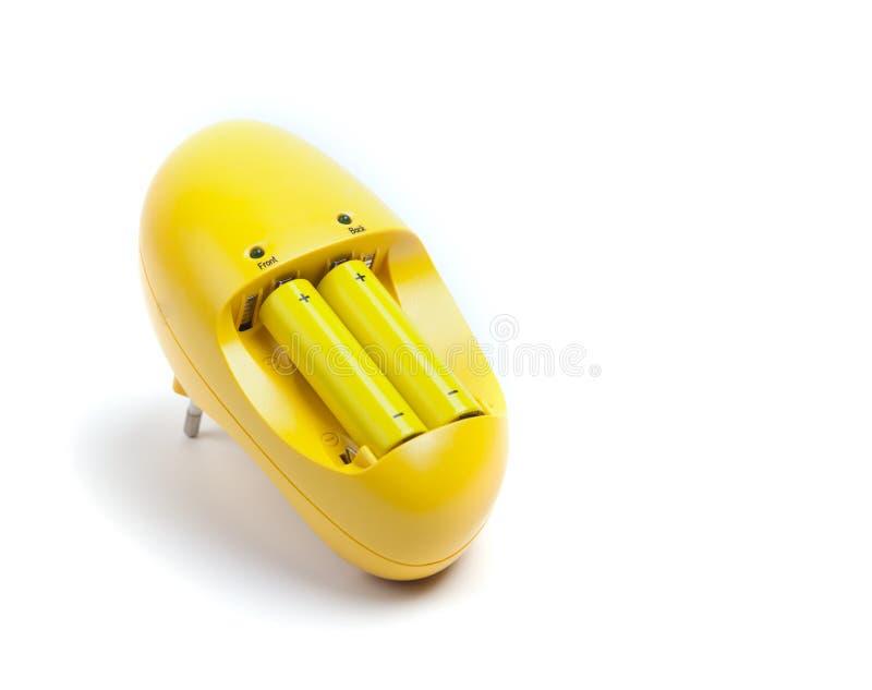 белизна предмета заряжателя батареи предпосылки изолированная стоковая фотография