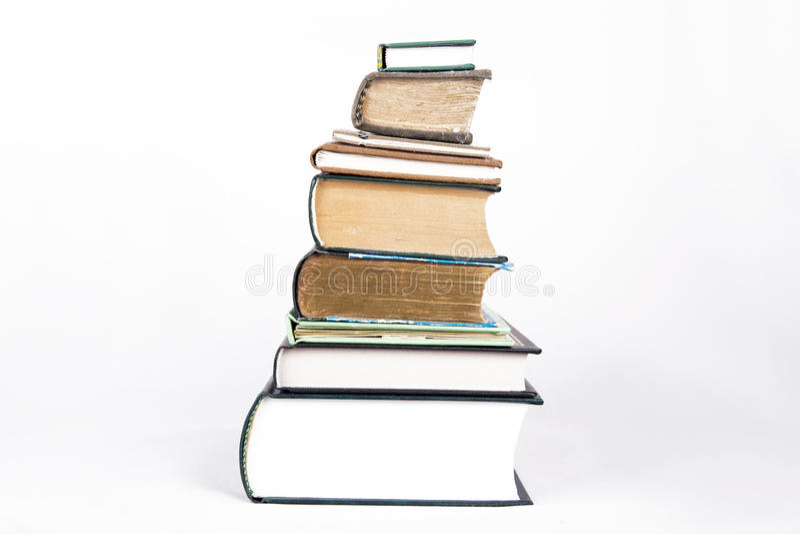 белизна стога книг предпосылки стоковое фото