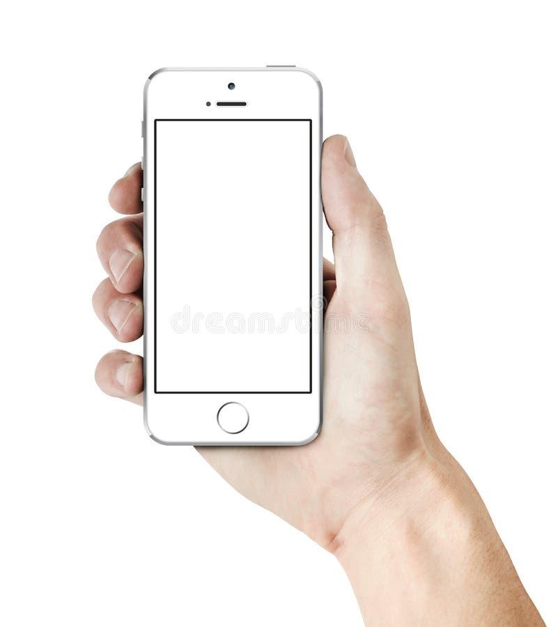 Белое iPhone 5s в руке стоковые изображения