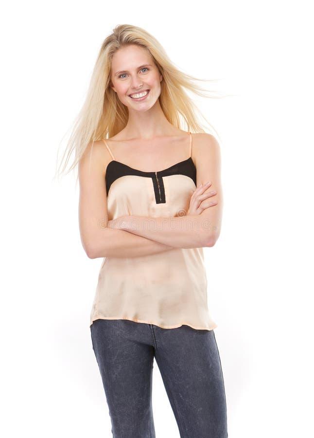 Download Белокурая женщина усмехаясь при пересеченные оружия Стоковое Изображение - изображение насчитывающей счастливо, длиной: 40583067