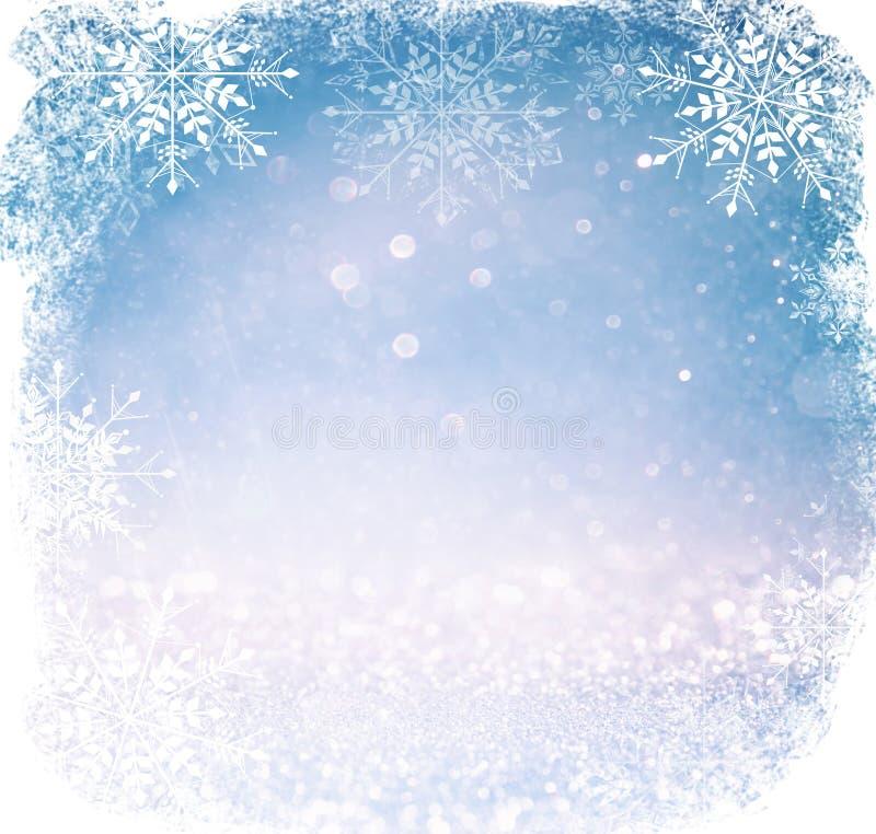 Белые и серебряные абстрактные света bokeh defocused предпосылка с верхним слоем снежинки стоковое изображение