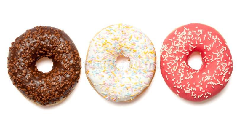 Белые, красные и коричневые donuts стоковое изображение