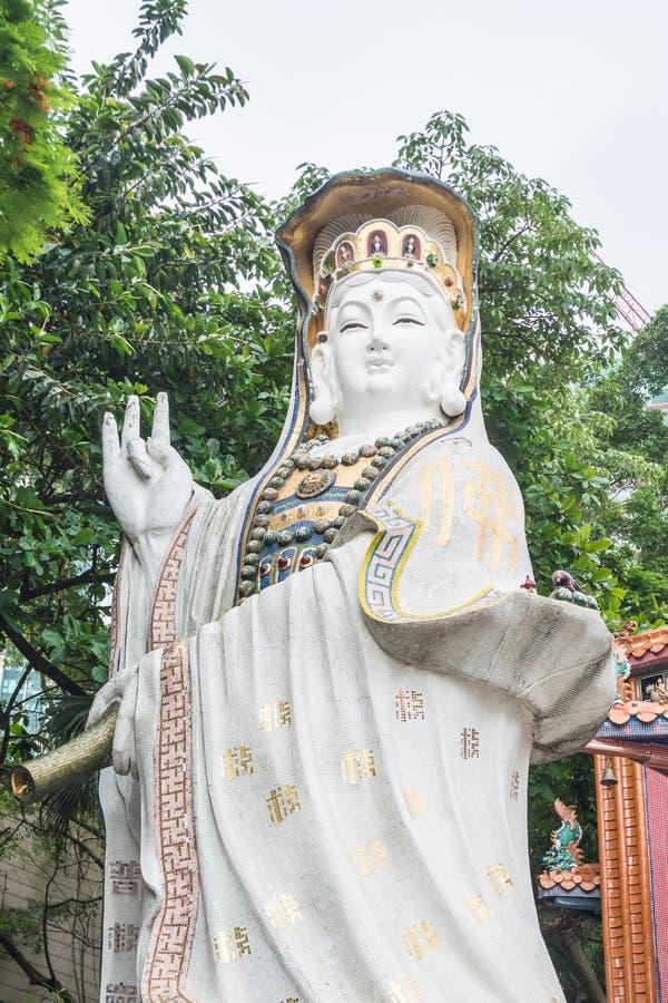 Белые статуи Kwun Яма на виске Kwun Яма, Гонконге стоковое фото