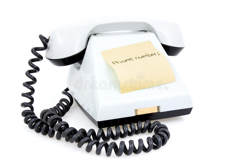 Белый телефон с липким примечанием стоковая фотография