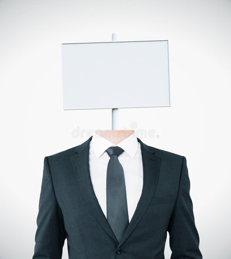 Белый шильдик возглавил бизнесмена стоковое фото rf