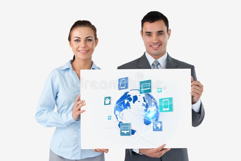 Бизнесмены держа панель с значками против белой предпосылки стоковое изображение rf