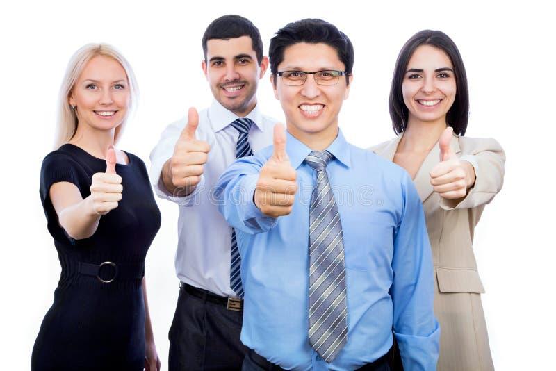 Бизнесмены показывая большие пальцы руки поднимают знак стоковая фотография rf