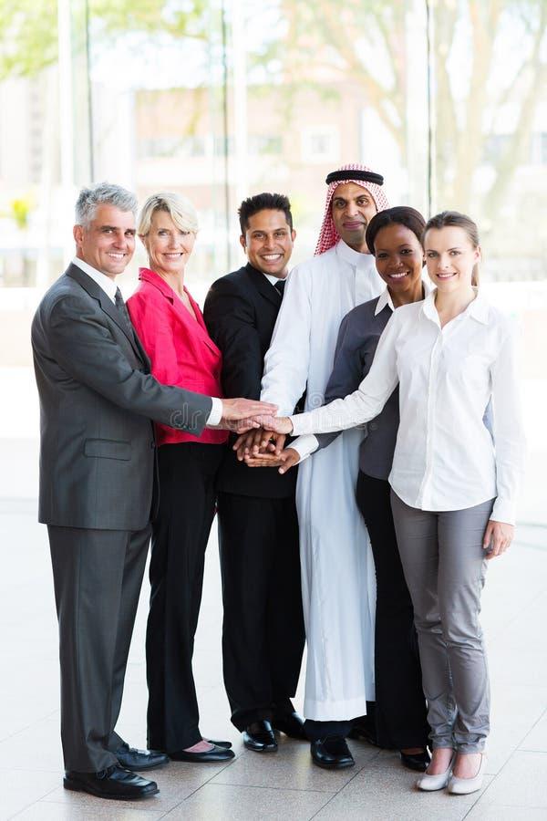 Бизнесмены рук совместно стоковое фото