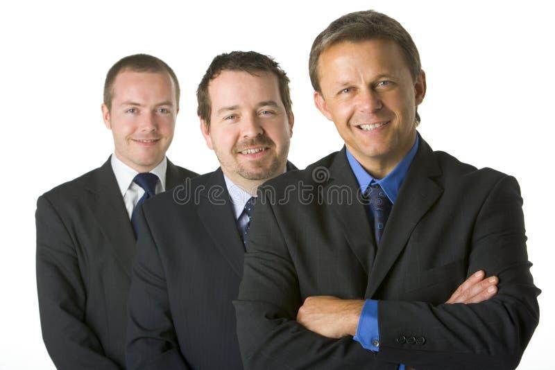 бизнесмены собирают усмехаться стоковое изображение rf