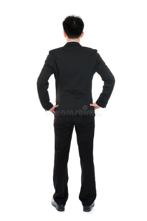 Бизнесмен азиата тела заднего взгляда полный стоковая фотография