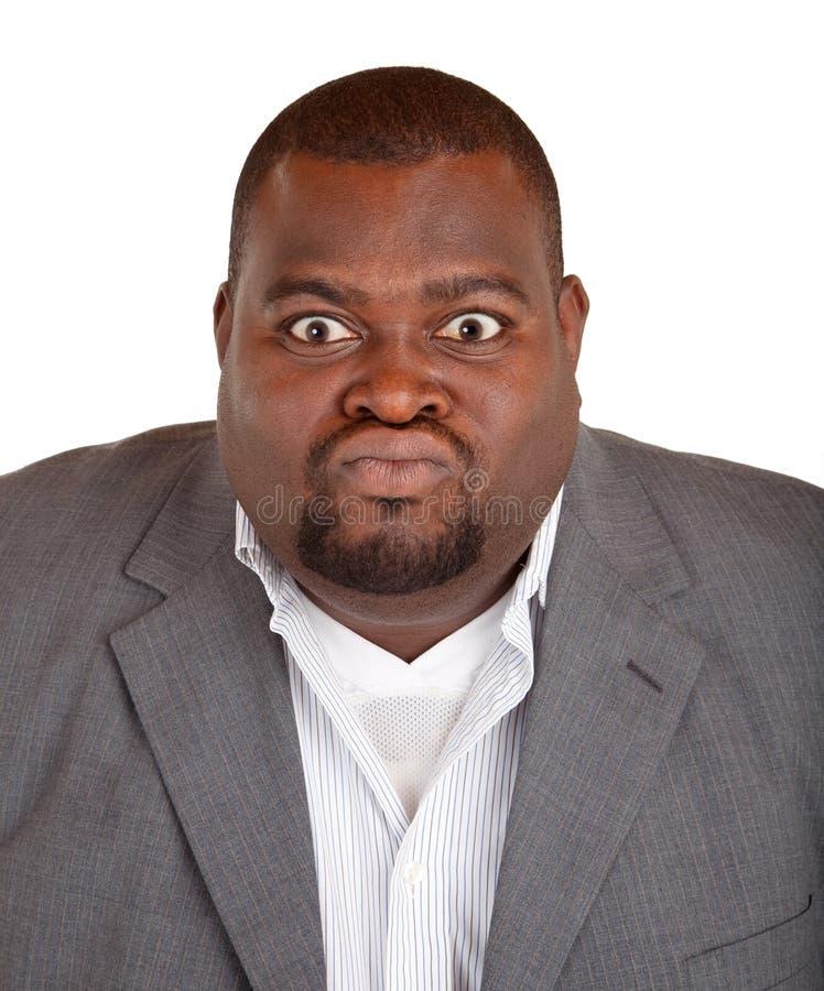 Бизнесмен афроамериканца сердитый о что-то стоковые изображения rf