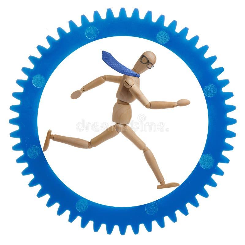 Бизнесмен бежать в cogwheel стоковые изображения rf
