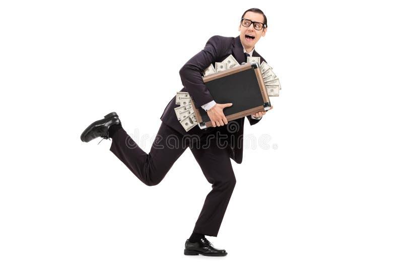 Бизнесмен бежать с сумкой полной денег стоковые изображения
