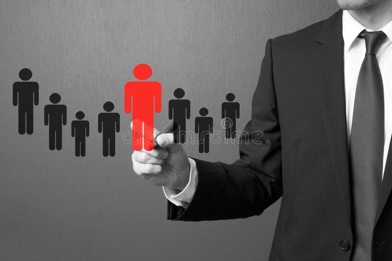 Бизнесмен выбирая правого партнера от много выбранных стоковое изображение