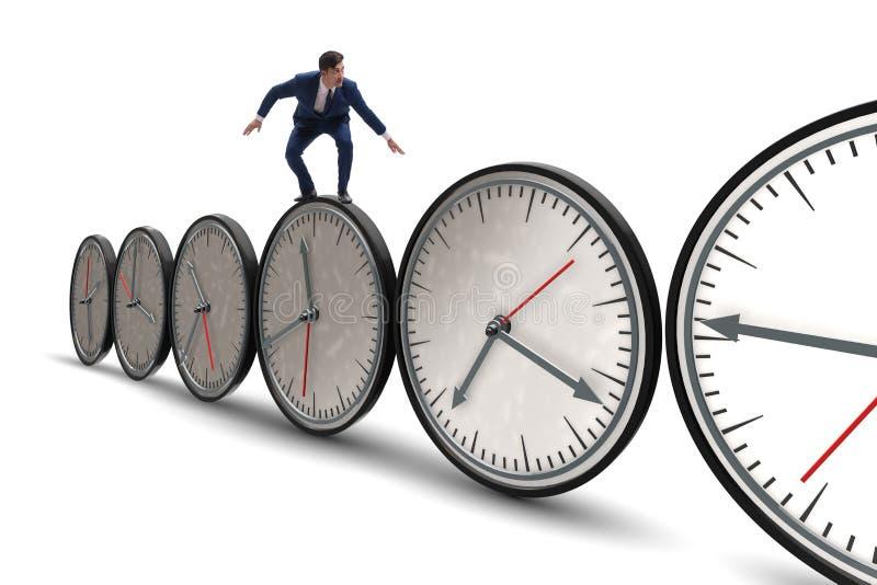 Бизнесмен в концепции контроля времени стоковая фотография