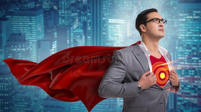 Бизнесмен в концепции супергероя с красной крышкой стоковые фотографии rf