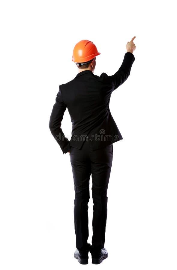 Бизнесмен в шлеме указывает палец вверх стоковые изображения rf