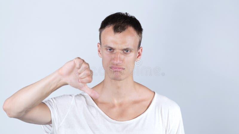 Бизнесмен давая большие пальцы руки вниз для новой идеи стоковое фото