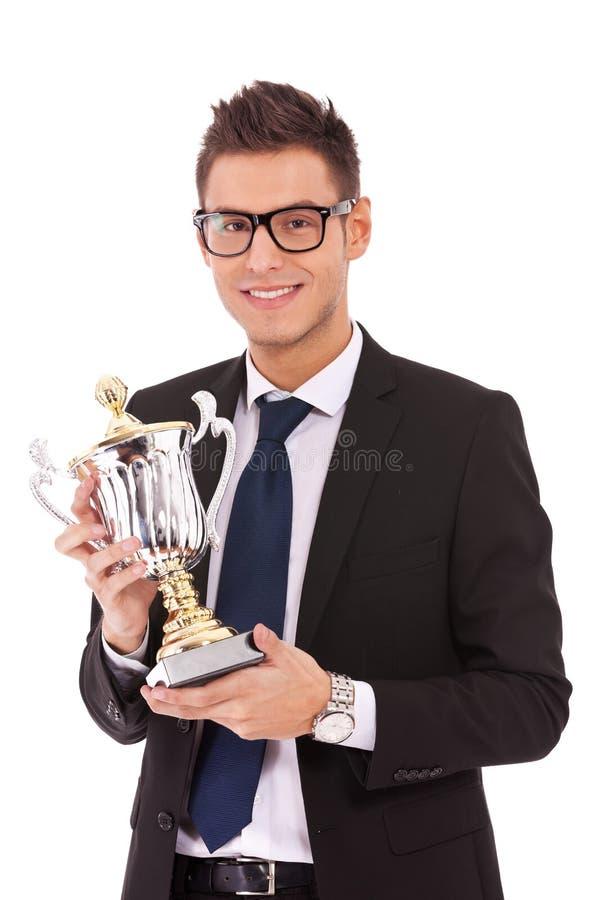 Бизнесмен держа трофей стоковые фотографии rf