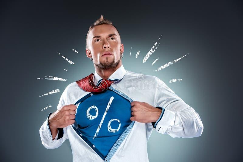 Бизнесмен действуя как супергерой и срывать стоковое фото rf