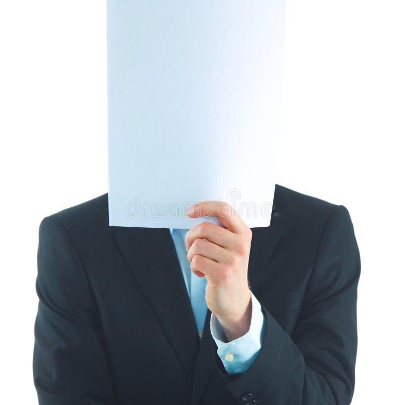 Бизнесмен держащ папки около стороны изолированной на белой предпосылке стоковая фотография