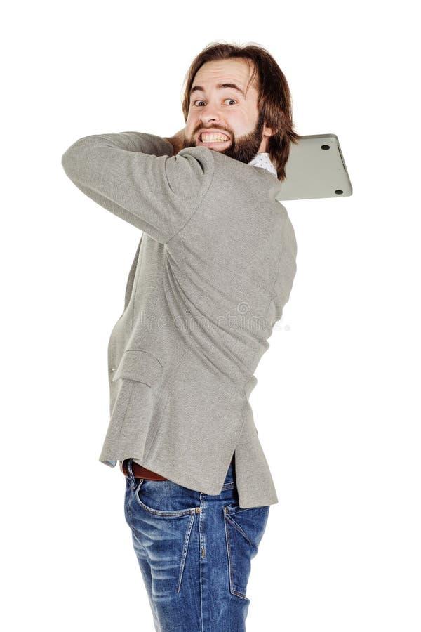 Бизнесмен держа компьтер-книжку надземный и кричащий стоковые изображения
