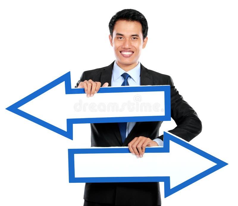Download Бизнесмен держа стрелку в руке Стоковое Фото - изображение насчитывающей счастливо, выбор: 37928578