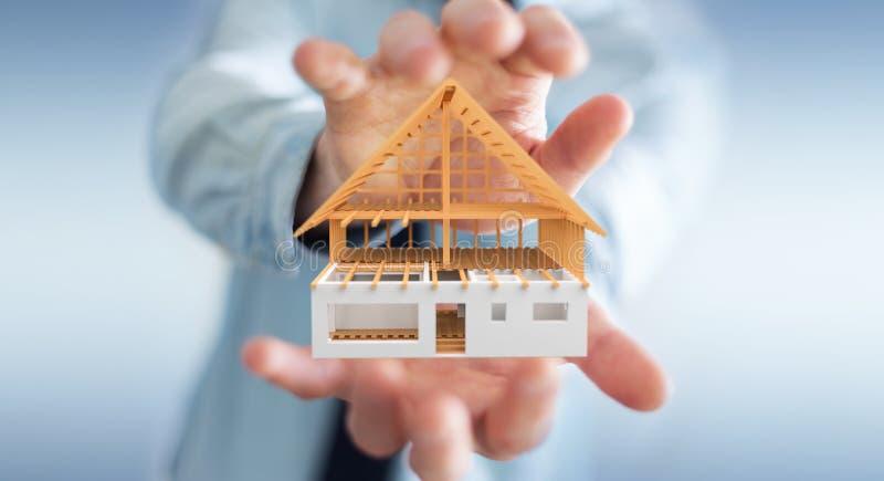Бизнесмен держа 3D представляя незаконченный дом плана в его ha бесплатная иллюстрация