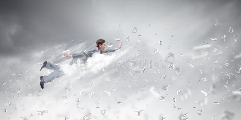 Download Бизнесмен летания стоковое фото. изображение насчитывающей потеха - 41650638