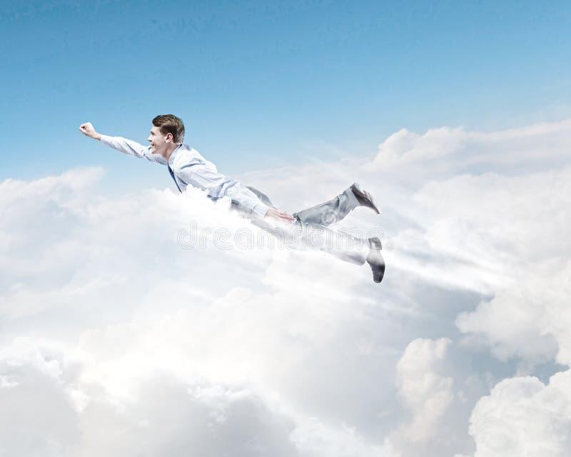 Download Бизнесмен летания стоковое изображение. изображение насчитывающей герой - 41651571