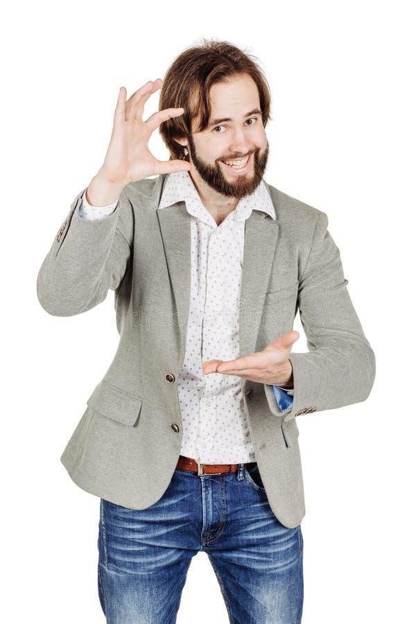 Бизнесмен делая его пальцами малый размер эмоции, уход за лицом стоковая фотография rf