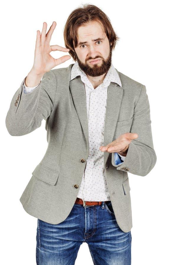 Бизнесмен делая его пальцами малый размер эмоции, уход за лицом стоковые фото