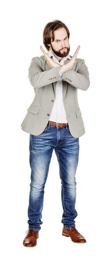 Бизнесмен делая знак стопа с рукой изображение на белой студии стоковое фото