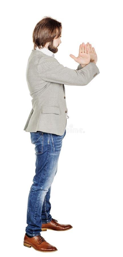 Бизнесмен делая знак стопа с рукой изображение на белой студии стоковое изображение