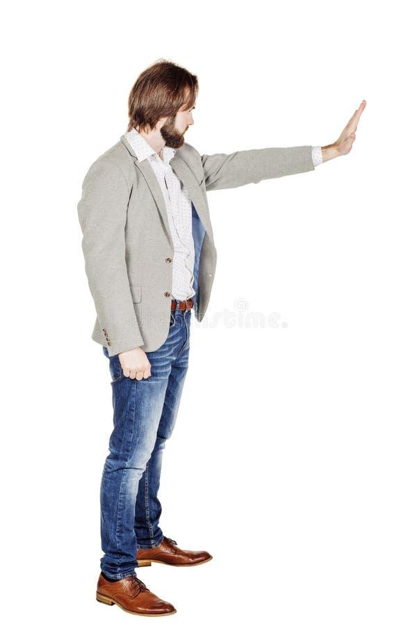 Бизнесмен делая знак стопа с рукой изображение на белой студии стоковые изображения