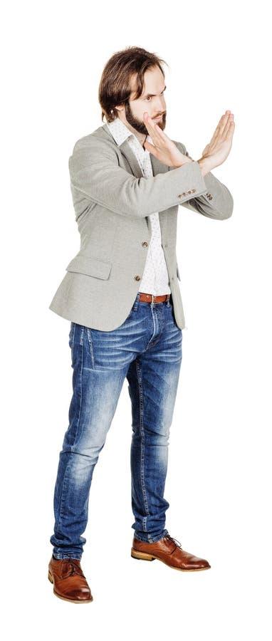 Бизнесмен делая знак стопа с рукой изображение на белой студии стоковое фото rf