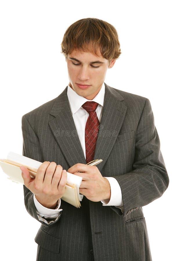 бизнесмен замечает принимает детенышей стоковая фотография