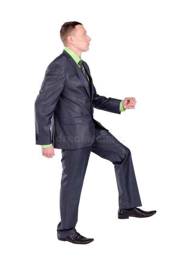 Бизнесмен идущ вверх изолирует стоковое изображение rf